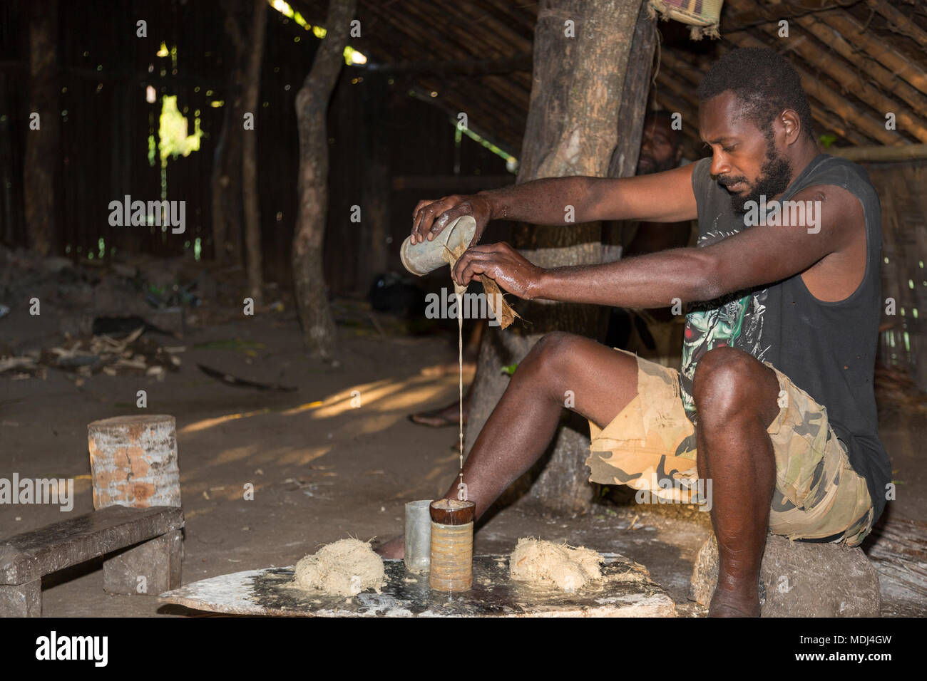 Pentecost, Republic of Vanuatu, July 21, 2014: Indigenous men participate in traditional Kava Ceremony. The consumption of the drink is a form of welc - Stock Image