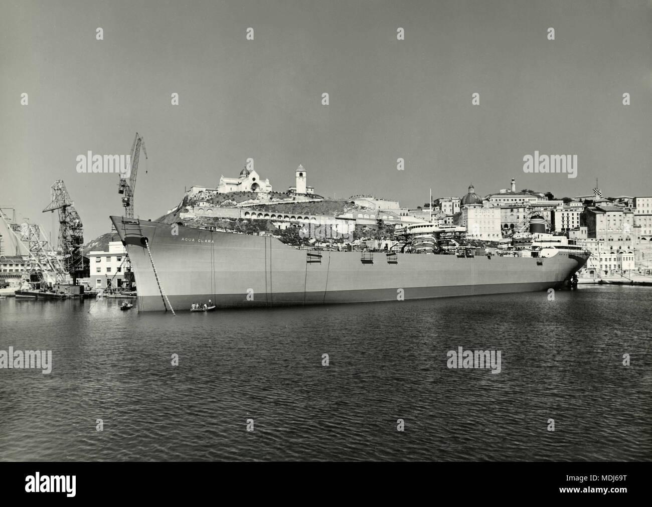 Agua Clara ship docked at Cantieri Navali Riuniti, Ancona shipyard, Italy 1950s - Stock Image