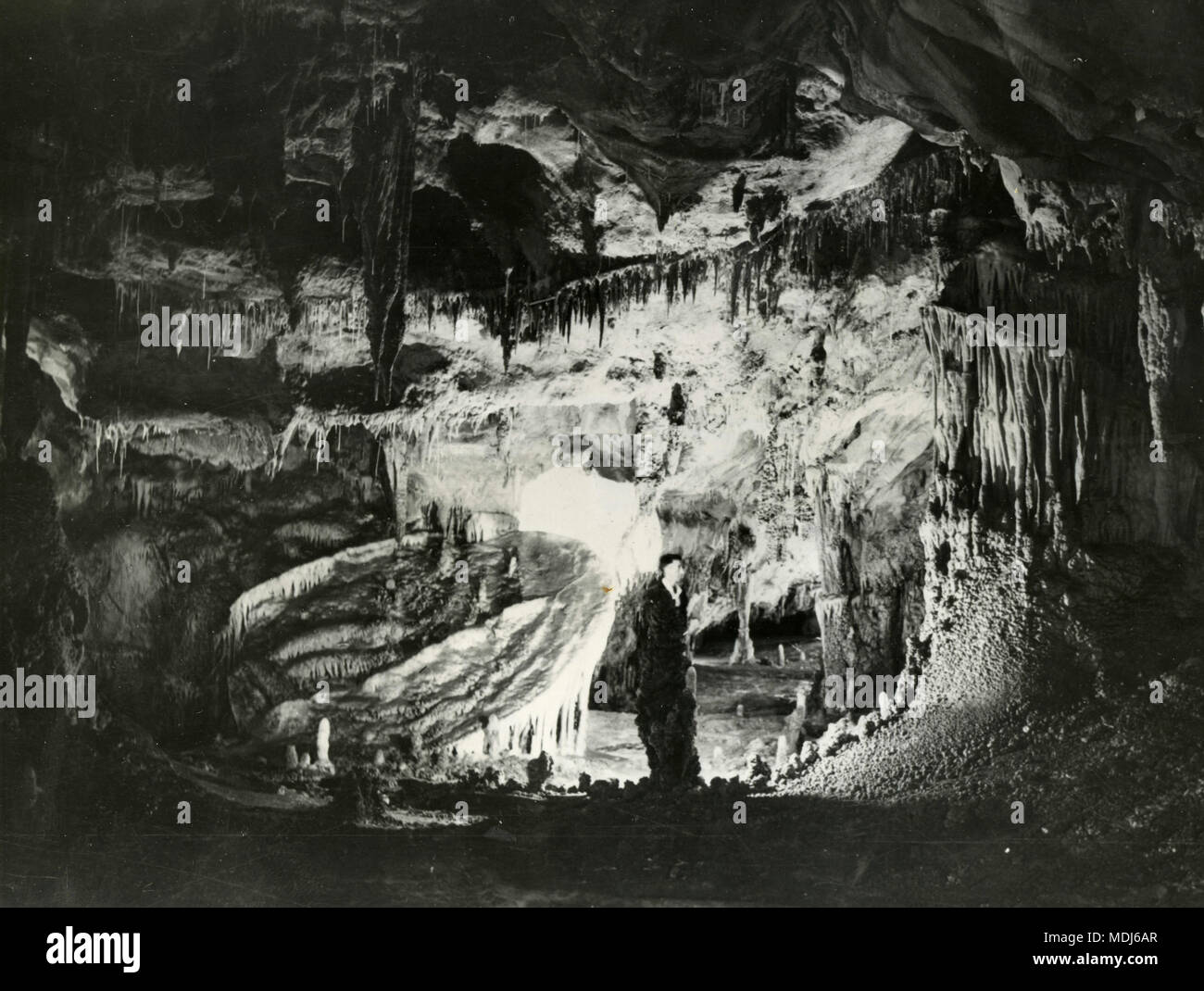 Inside a chimny cave carved by the Pas river, Spain 1950s - Stock Image