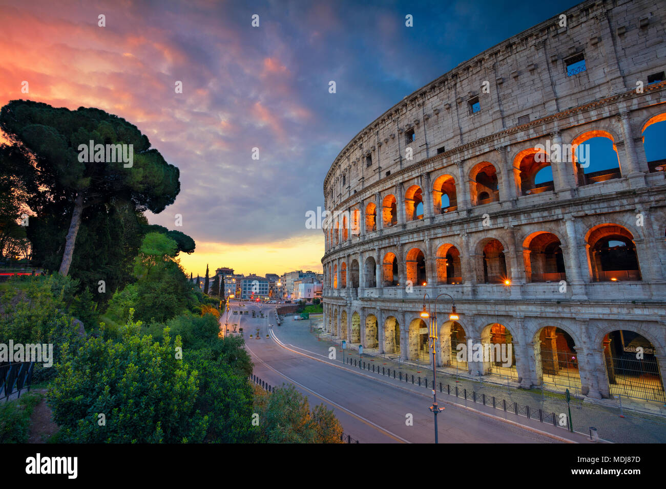 Colosseum. Image of famous Colosseum in Rome, Italy during beautiful sunrise. - Stock Image