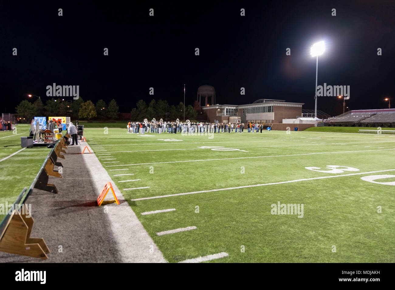 An evening rehearsal in a local football stadium - Stock Image