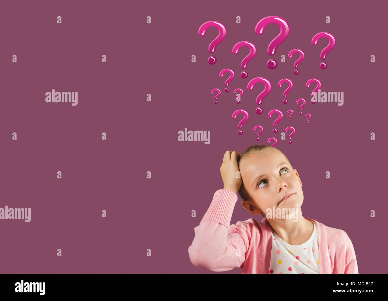 Woman with pink question marks emerging from head - Stock Image