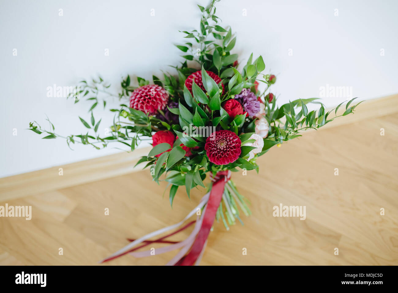 Wedding The Bride S Bouquet Rustic Bouquet Of Burgundy And Eucalyptus Flowers Wedding Stock Photo Alamy