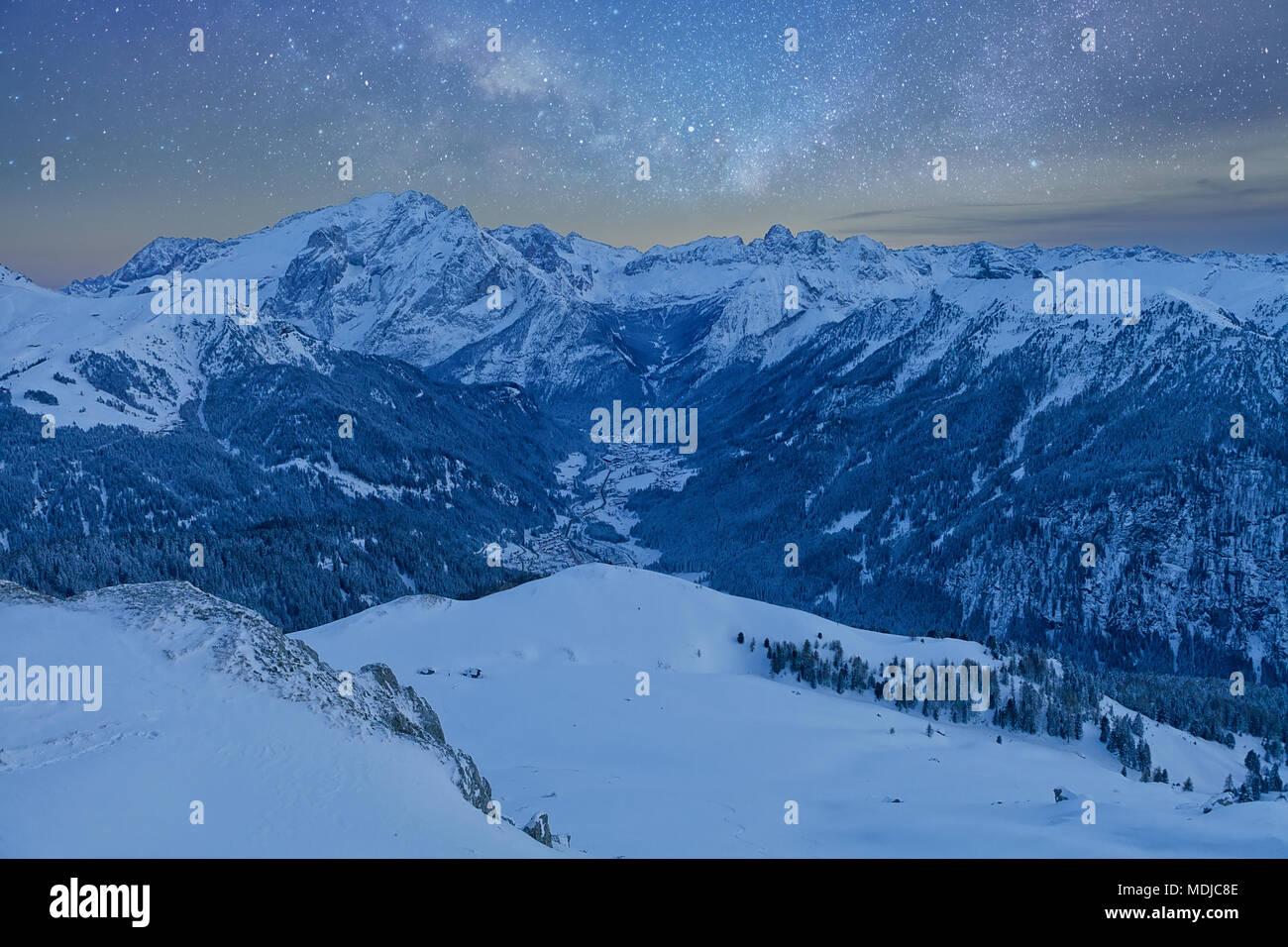 Fantastic starry sky. Panoramic view of the Val Di Fassa ski resort of the Italian Dolomite under starry light. Trentino-Alto-Adige region, Italy - Stock Image