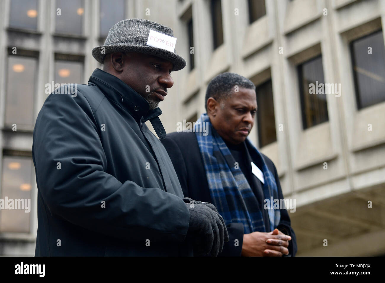 Philadelphia, USA. 19th Apr, 2018. Rev. Mark Tyler and Rev. Greg Holston, Executive Director of Philadelphians Organized to Witness, Empower and Rebuild (POWER), bow heads in prayer at a Police Accountability rally hosted by POWER outside Police Dept. headquarters in center City Philadelphia, PA, on April19, 2018. Credit: Bastiaan Slabbers/Alamy Live News Stock Photo