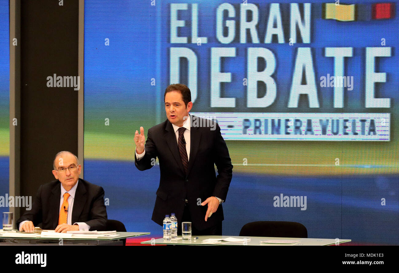 The candidate for the Presidency of Colombia German Vargas Lleras (R) participates in the first major national debate in Bogota, Colombia, 19 April 2018. The great debate, the first one of national level, was organized by RCN Television, the National Federation of Merchants (Fenalco), in alliance with the Institute of Political Science, the Concordia Institute, and NTN24. The presidential elections will be held on May 27. EFE/Leonardo Munoz - Stock Image