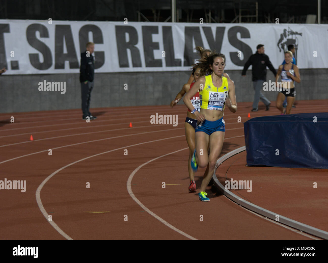 Walnut, California, USA. 19th Apr, 2018. Eventual champion Camilla Richardsson (right, background) closes in on the lead pair of Elaina Tabb (Balouris, front) and Gladys Tejeda Pucuhuaran, as they pass another runner during the first of two Invitational sections of the women's 10k, at the 2018 Mt. SAC Relays. Credit: Omari Stephens/Alamy Live News - Stock Image