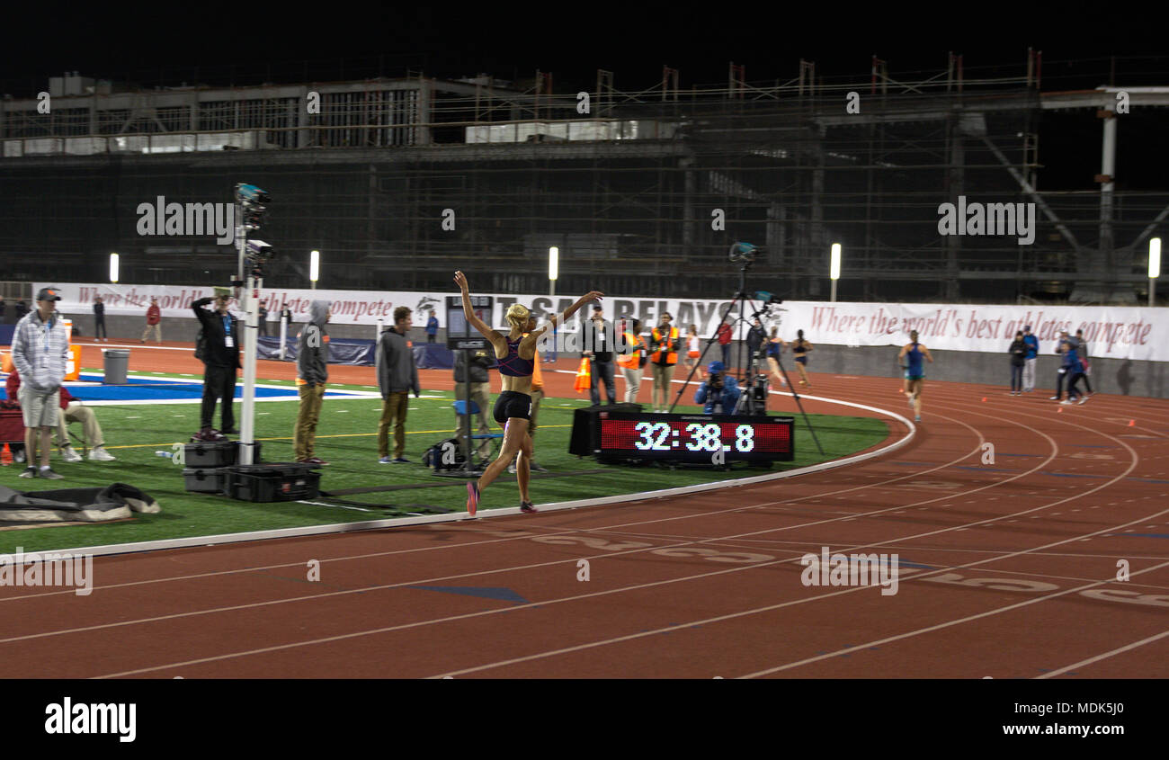 Walnut, California, USA. 19th Apr, 2018. Camilla Richardson bounds toward the finish line with arms raised as she wins the first of two Invitational sections of the Mt. SAC Relays women's 10k in a European Championship qualifying mark of 32:39.01. Credit: Omari Stephens/Alamy Live News - Stock Image