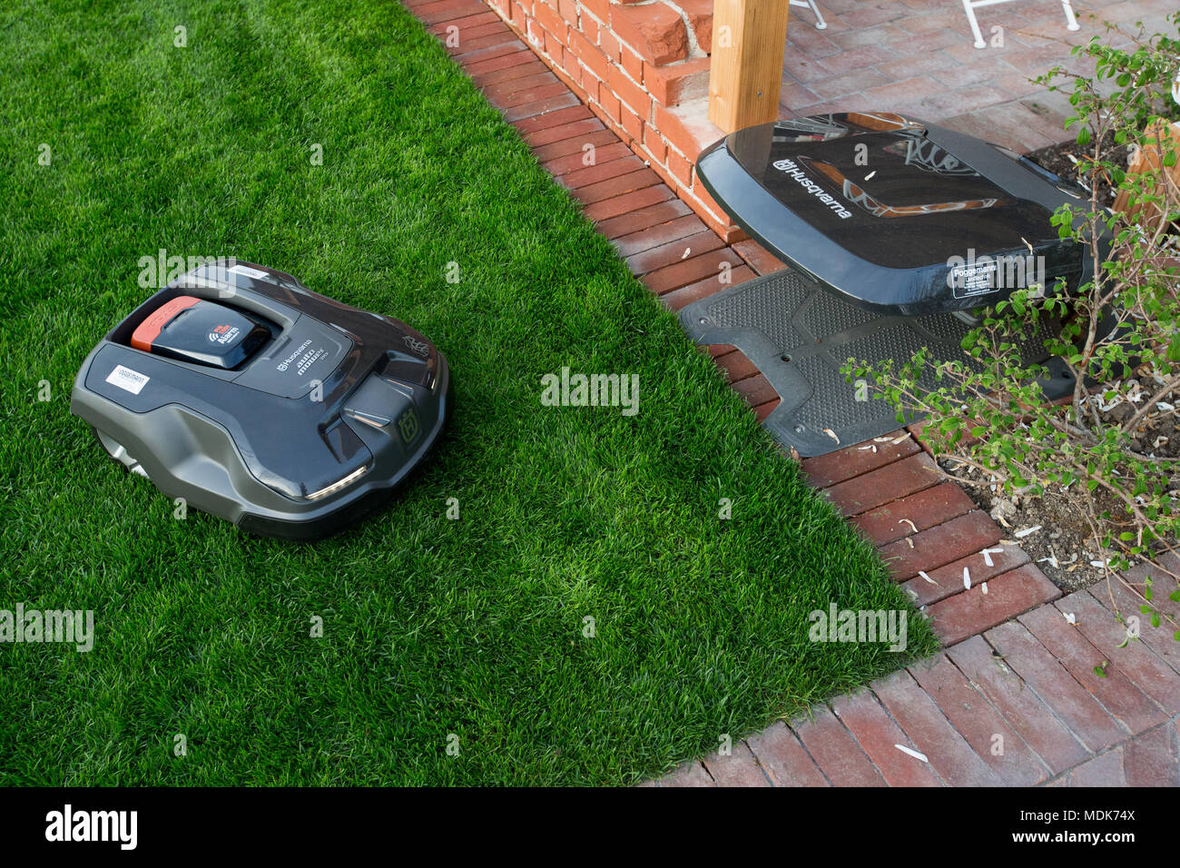 17 April 2018, Germany, Bad Iburg: An lawn mowing Husqvarna Automower robot cats the lawn on the premises of the the regional horticultural show. Photo: Friso Gentsch/dpa - Stock Image