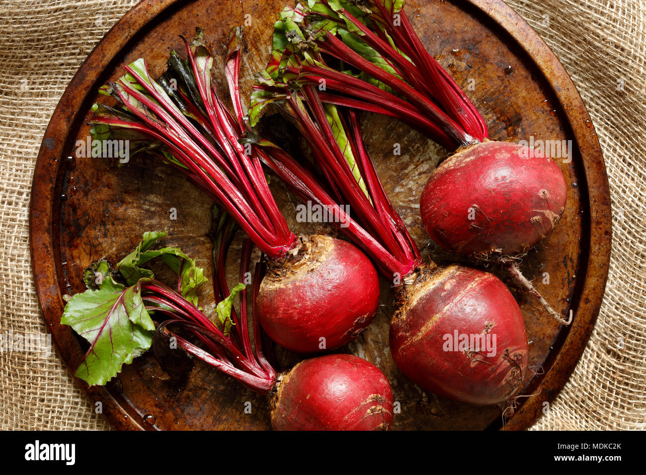 Close-up of fresh beetroots on metal tray on hessian sack cloth Stock Photo