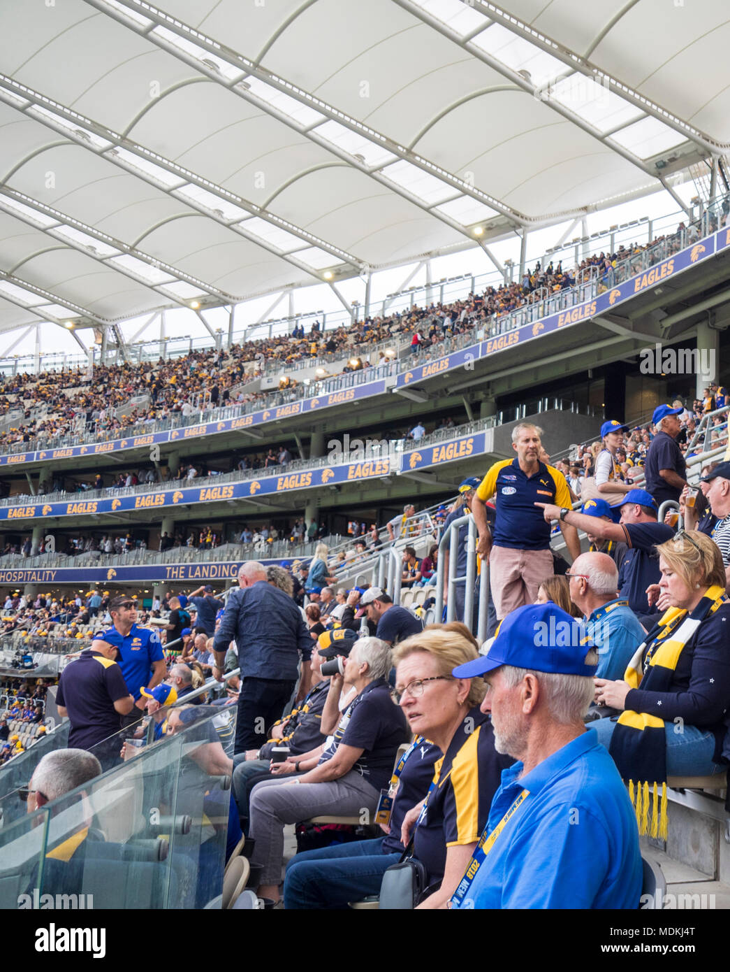 West Coast Eagles supporters seated in the grandstands of the Optus Stadium, Perth, WA, Australia. - Stock Image