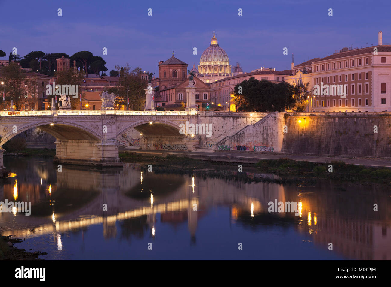 View over the Tiber to St. Peter's Basilica at dusk, Rome, Lazio, Italy - Stock Image