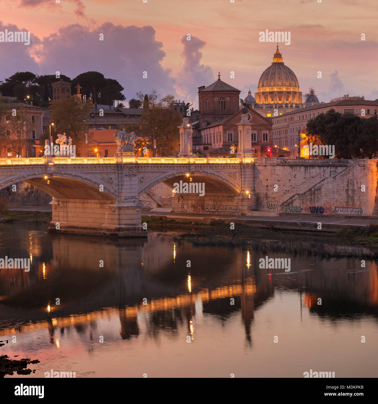 View over the Tiber to St. Peter's at sunset, Rome, Lazio, Italy - Stock Image