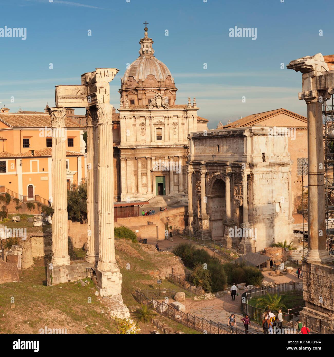 Roman Forum with Saturn Temple and Severus Arch, Foro Romano, Rome, Lazio, Italy - Stock Image