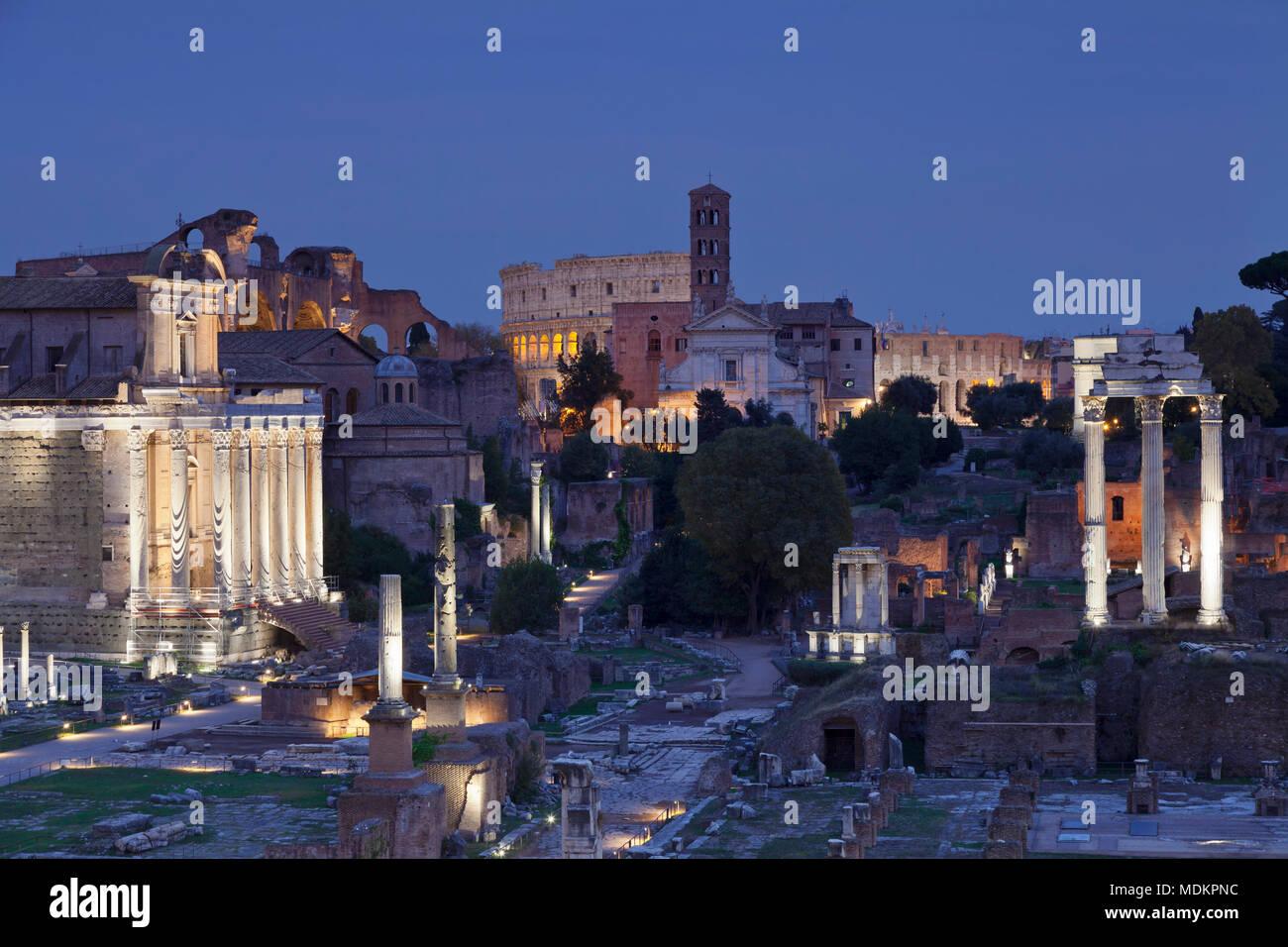 Roman Forum with Colosseum behind, Dawn, Foro Romano, Rome, Lazio, Italy - Stock Image