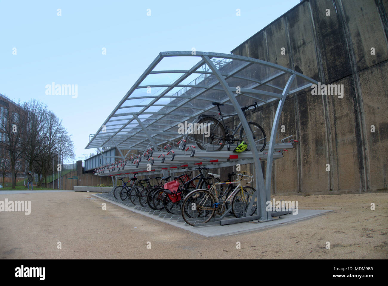 Partick station transport hub subway bus  train commuter cycle parking solution bicycle shelter enclosure  rack hub metal compound canopy tier tiered - Stock Image