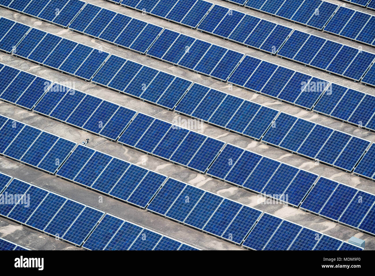 Solar panels installed on building roof in Adelade, South Australia - Stock Image