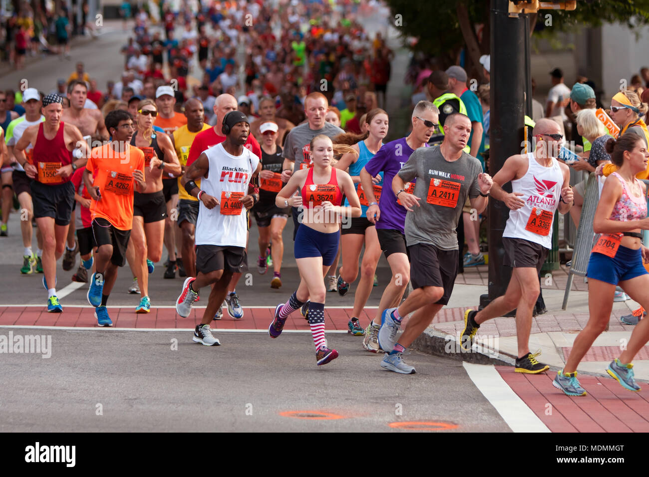 Thousands of runners run down Peachtree Street on their way to the finish line of the Peachtree Road Race on July 4, 2014 in Atlanta, GA. - Stock Image