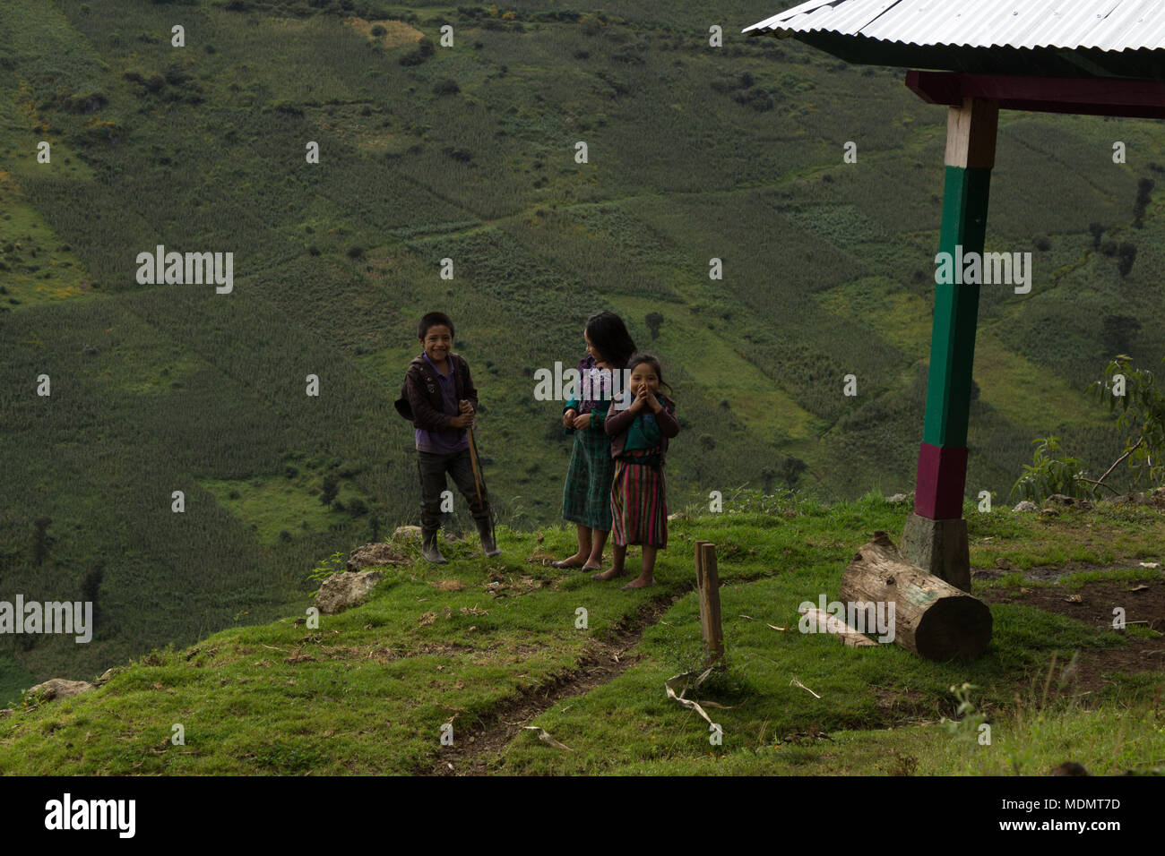 Some kids amused by strangers in a remote town in the mountains of Huehuetenango, Guatemala. Stock Photo