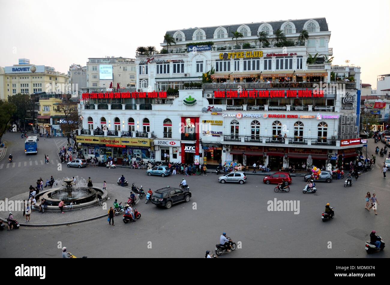 Old Colonial Building And Roundabout And Traffic Including Pedestrians With Fast Food Restaurants Hanoi S Old Quarter Vietnam Stock Photo Alamy