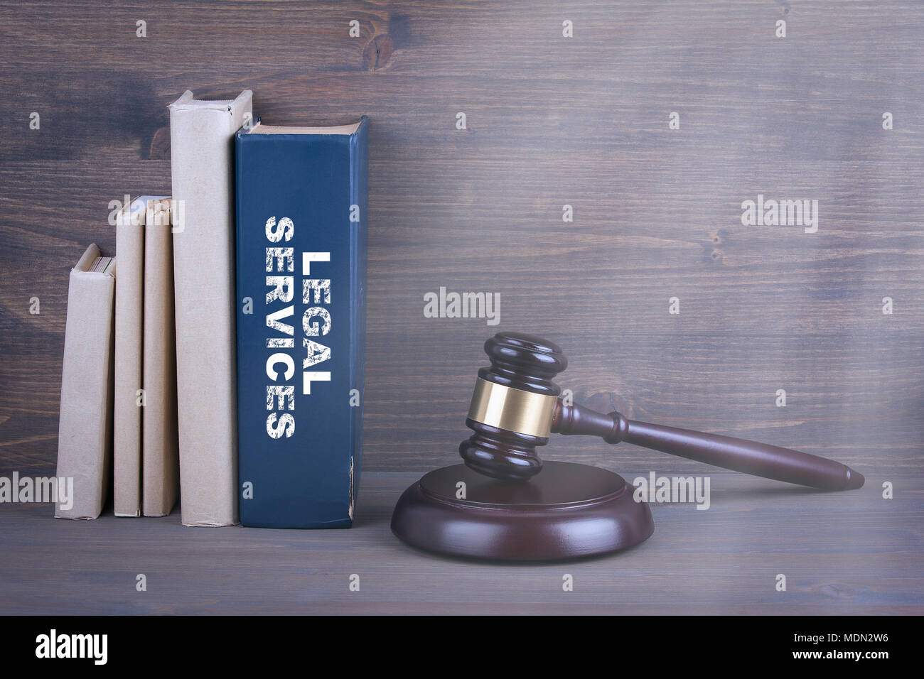 Legal Services. Wooden gavel and books in background. Law and justice concept - Stock Image
