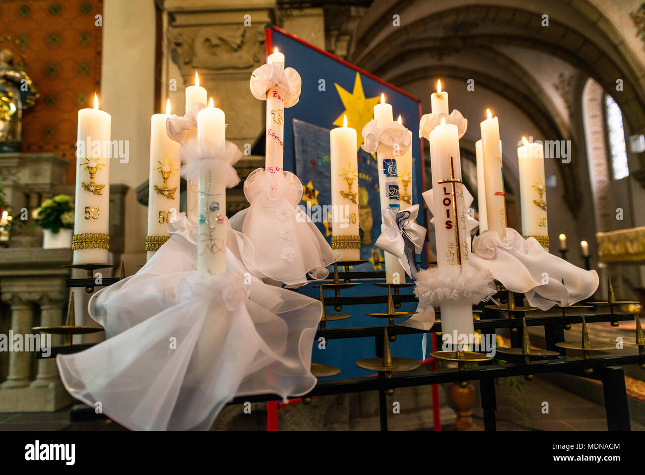 First Holy Communion Or Confirmation Burning Candles Rowed Up In