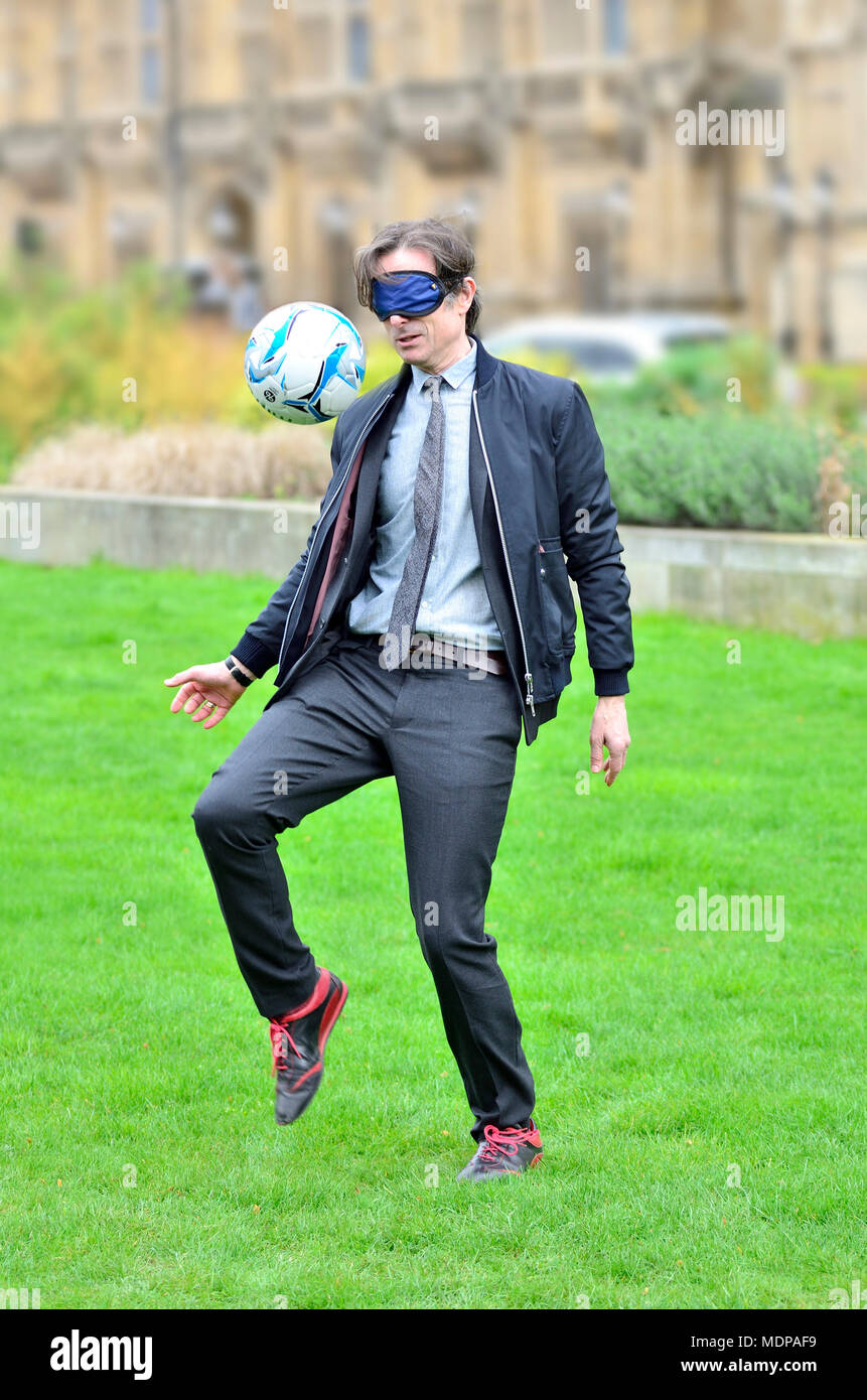 Robert Peston (ITV News Political Editor) taking part in the DFID (Dept for  International Development) Blindfold Keepie Uppie Challenge in aid of Socc