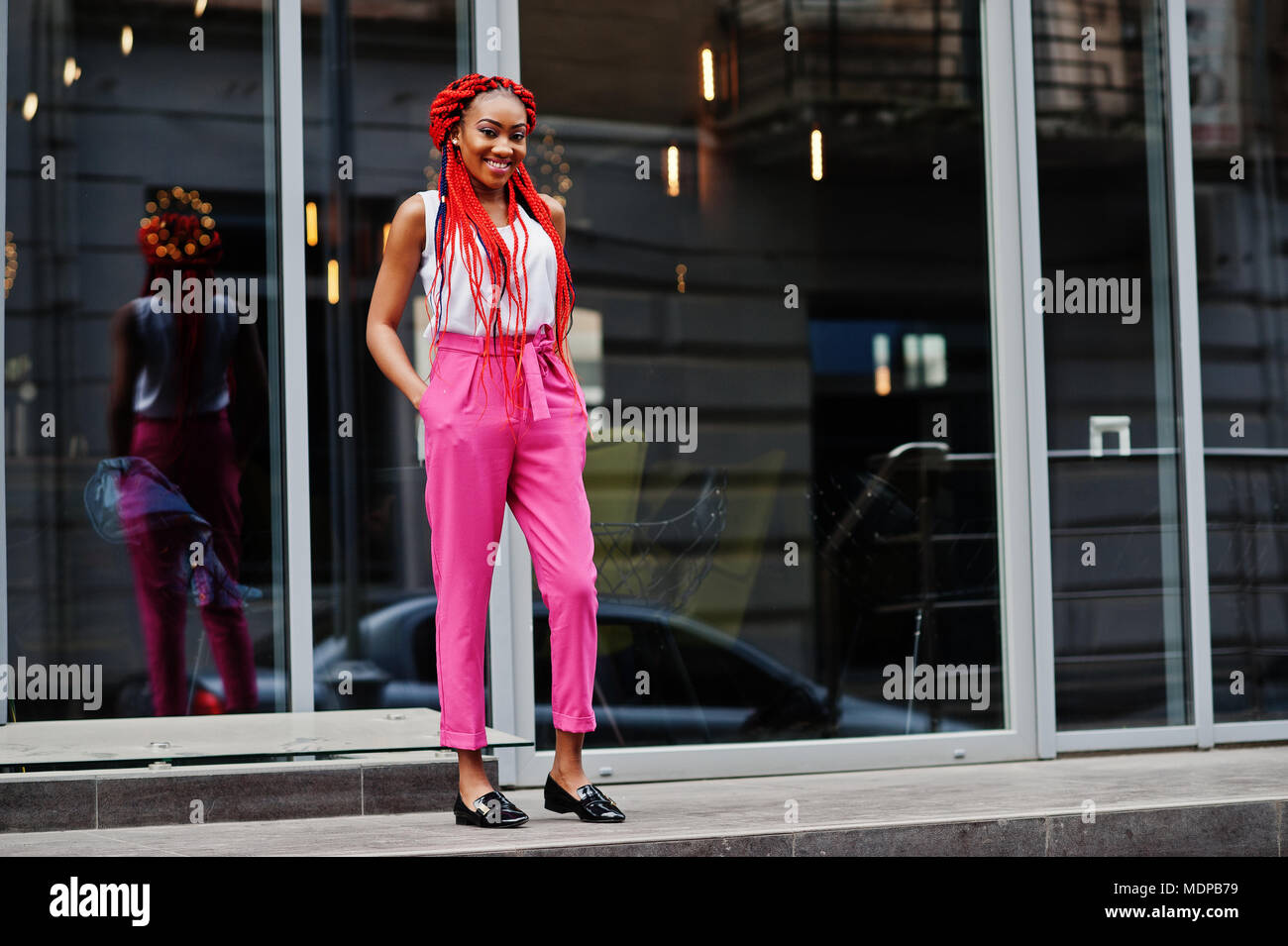 Fashionable African American Girl At Pink Pants And Red Dreads Posed Outdoor Stock Photo Alamy