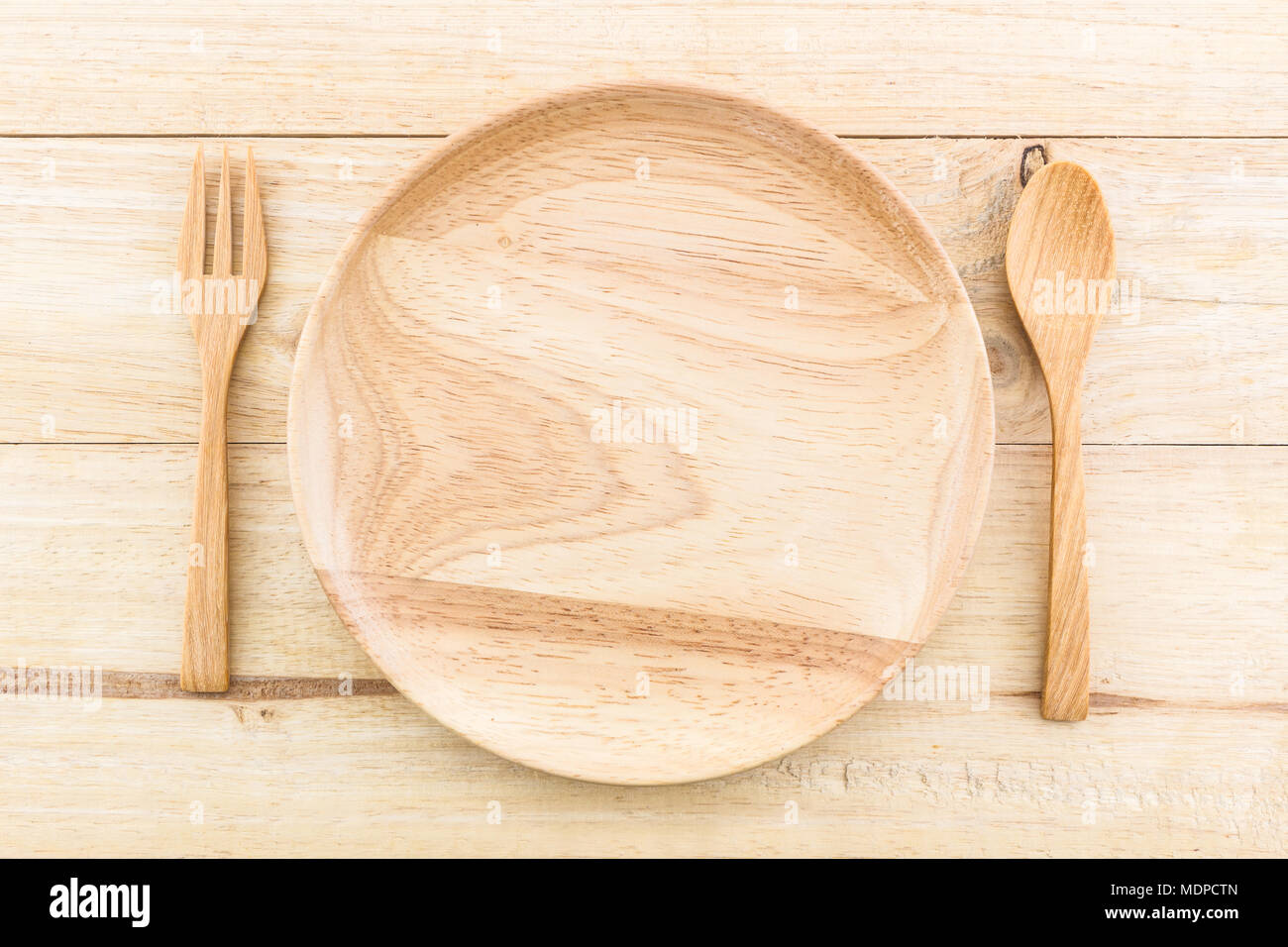 Empty Wooden Plate And Spoons Forks On Table Wood Texture Background Stock Photo Alamy