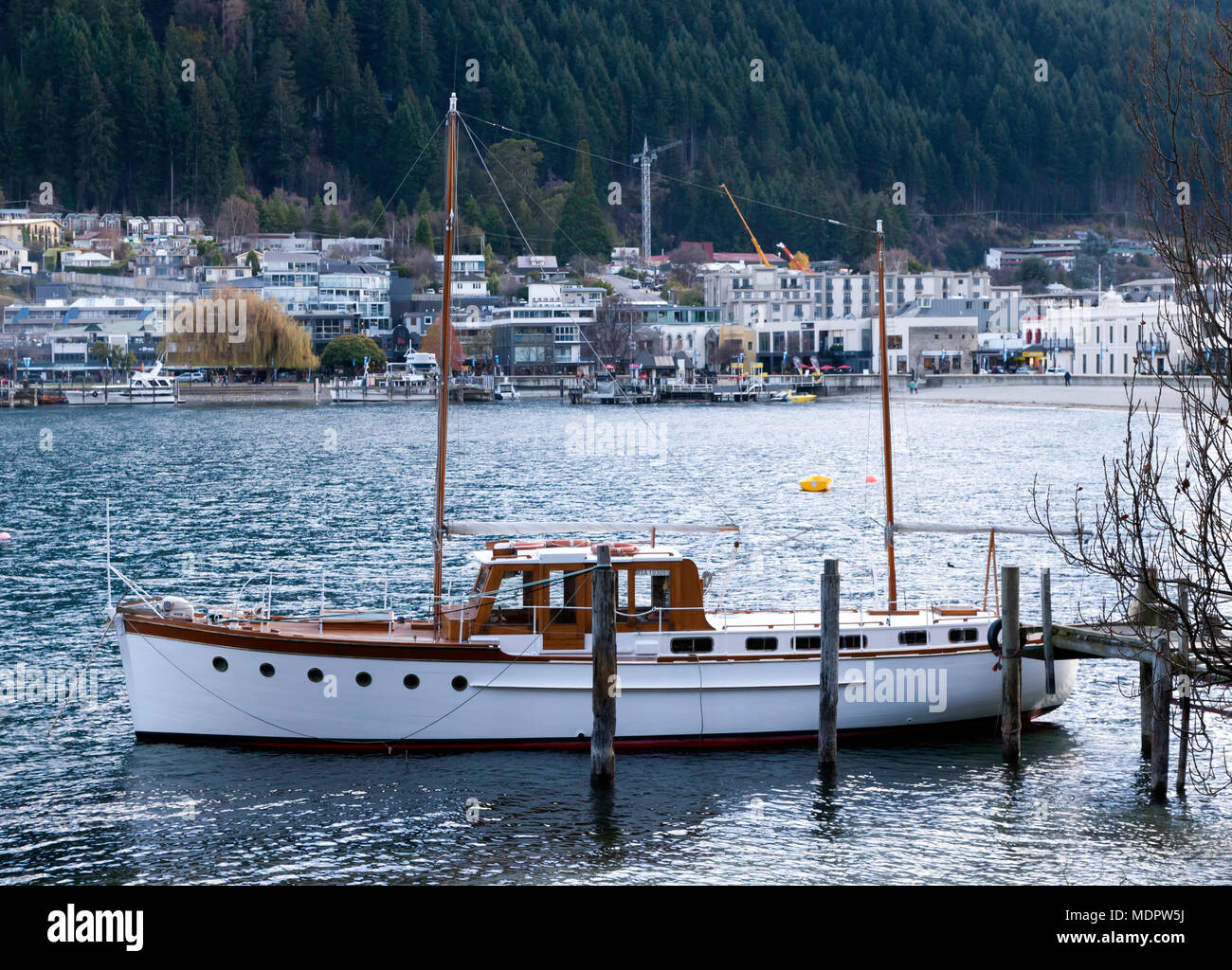 View of the Ketch Yvalda, moored in Queenstown Bay,   taken from from the Queenstown  Botanical Gardens, Queenstown, South Island, New Zealand - Stock Image