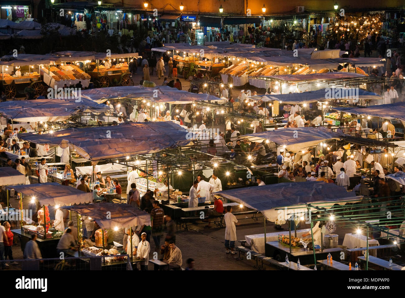 Marrakesh, Morocco; view of the Djemaa el Fna at sunset. Stock Photo
