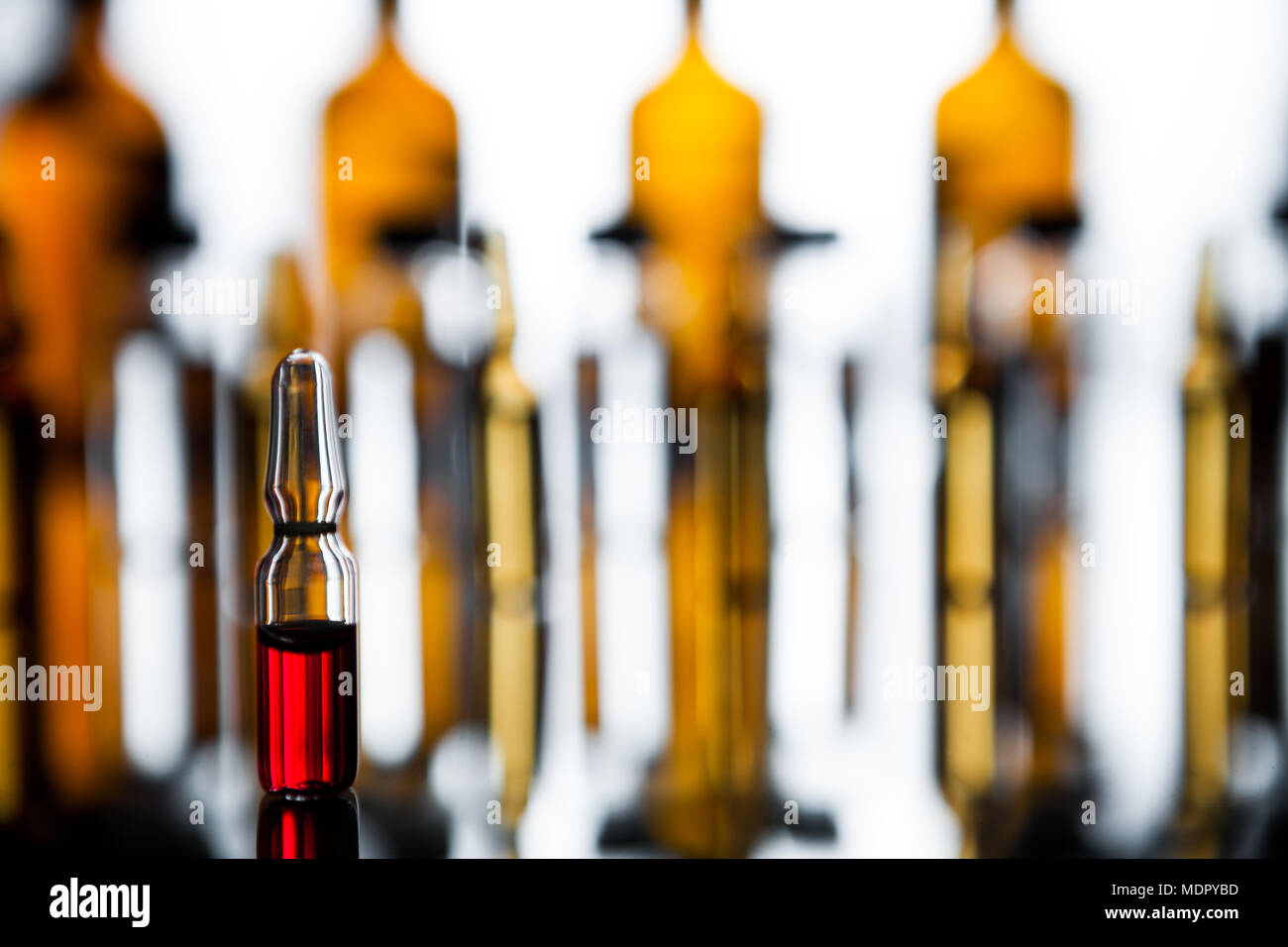 Production of medicines  lot of ampoules on light background  Group
