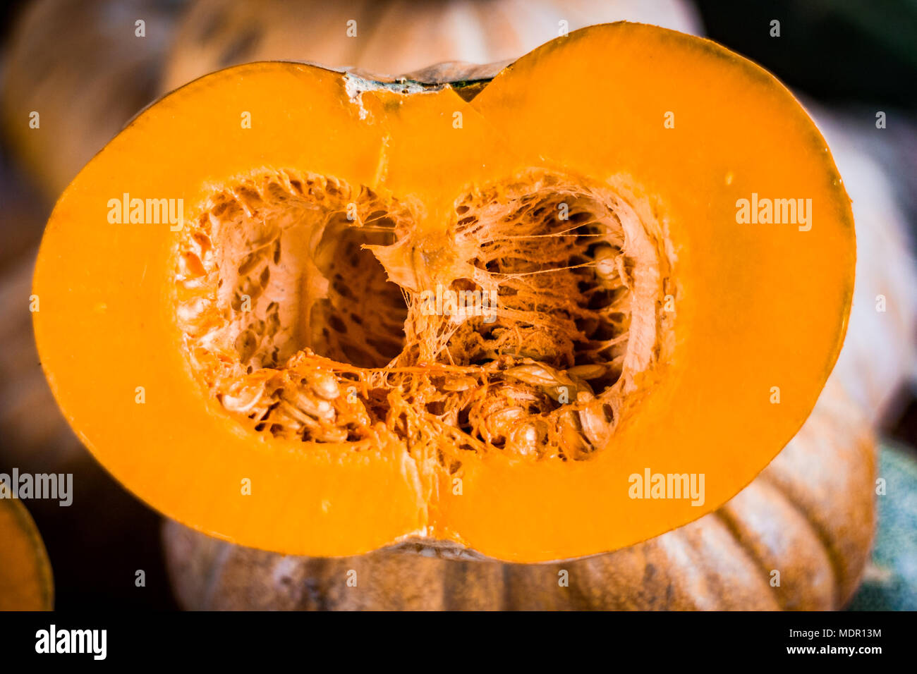 cut pumpkin displayed for sale at vegetable market Stock Photo