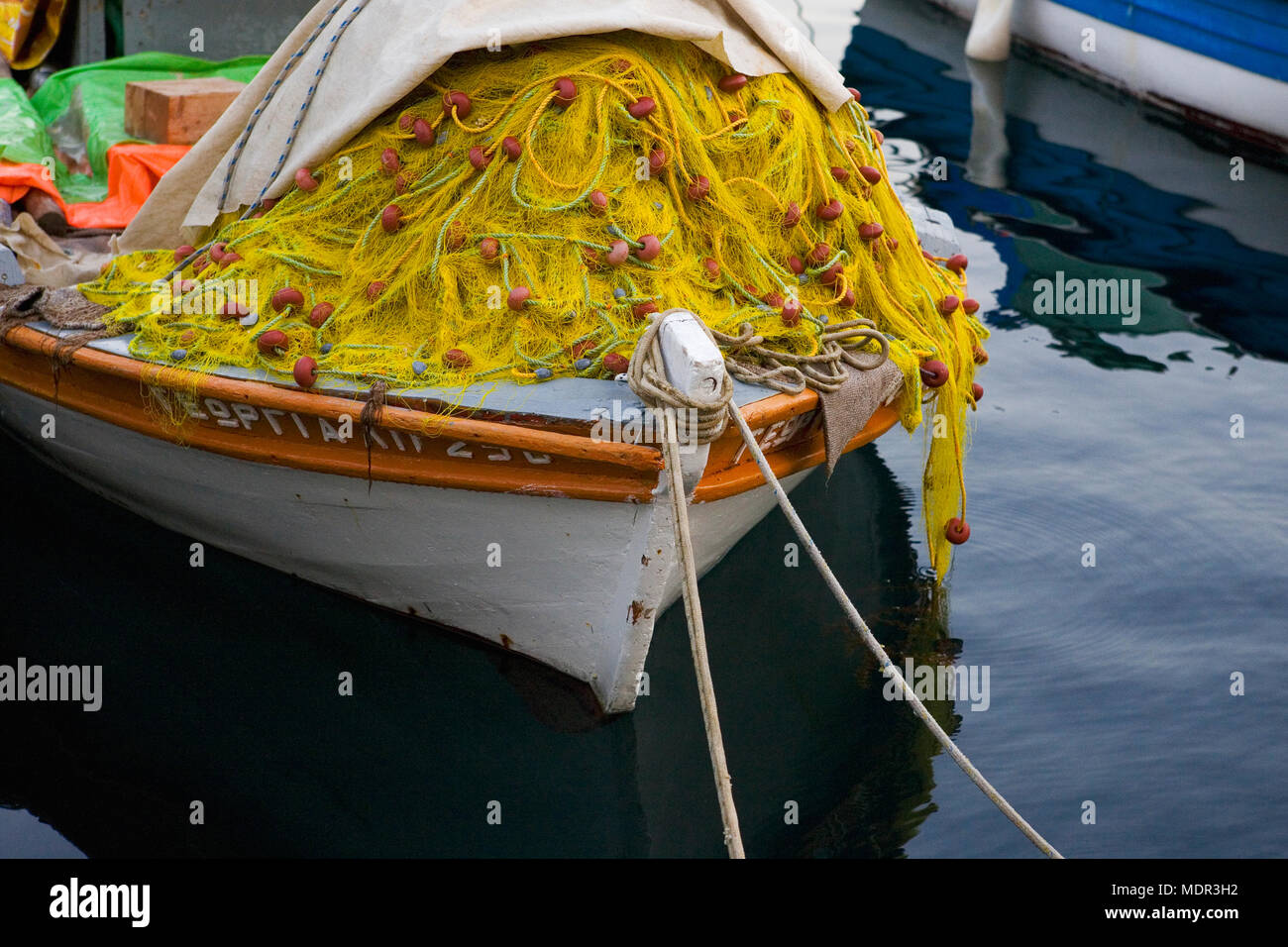 Fishing boat loaded with nets, Gaios harbour, Paxos, Greece - Stock Image