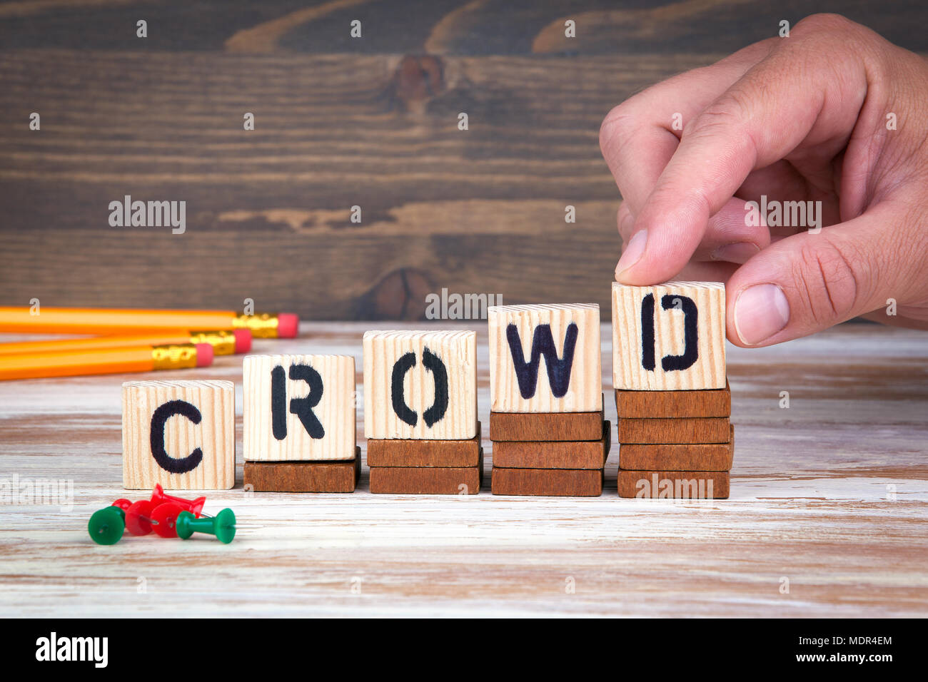 Crowd concept. Wooden letters on the office desk, informative and communication background - Stock Image