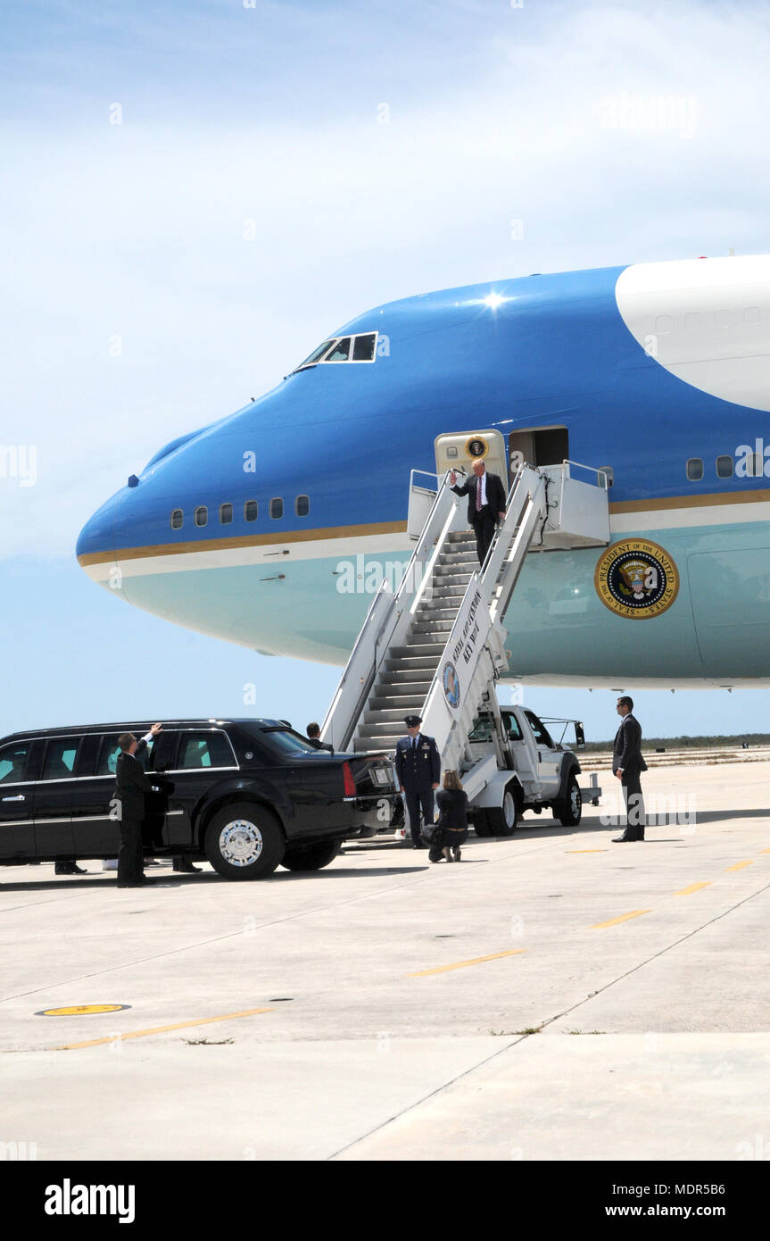 KEY WEST, Florida (April 19, 2018) President of the United States Donald J. Trump disembarks Air Force One at Naval Air Station Key West's Boca Chica Field. During the president's trip to Key West, he spoke to service members and guests and received a brief from Joint Interagency Task Force South, U.S. Northern Command and U.S. Southern Command. NAS Key West is a state-of-the-art facility for air-to-air combat fighter aircraft of all military services and provides world-class pierside support to U.S. and foreign naval vessels. (U.S. Navy photo by Jolene Scholl/Released) - Stock Image