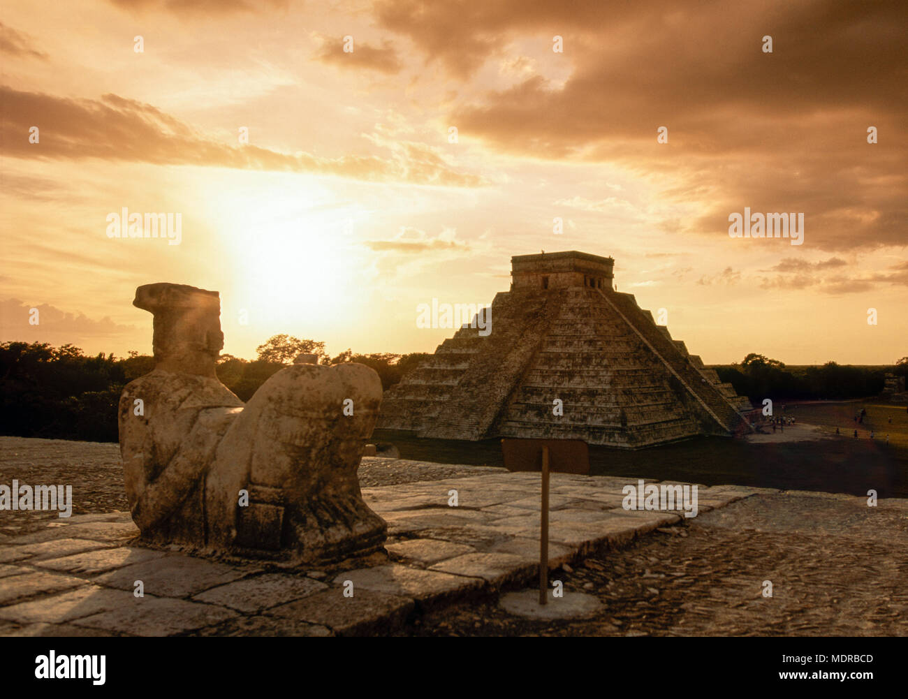 Chichen Itza, Yucatan, Mexico; el Castillo with statue of Chac Mool in foreground at sunset - Stock Image
