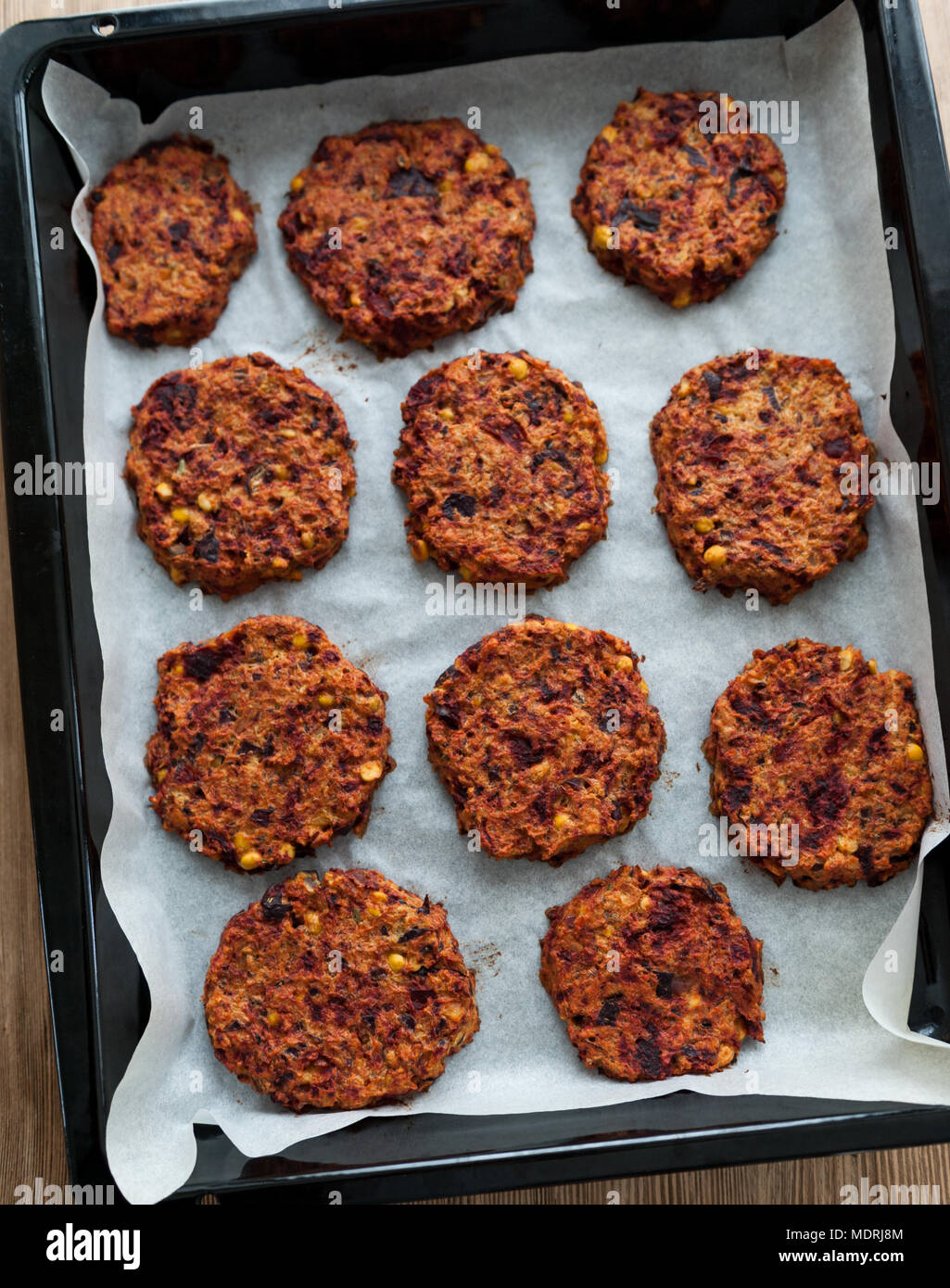 Vegetarian burgers with chickpeas and beetroot in the oven Stock Photo