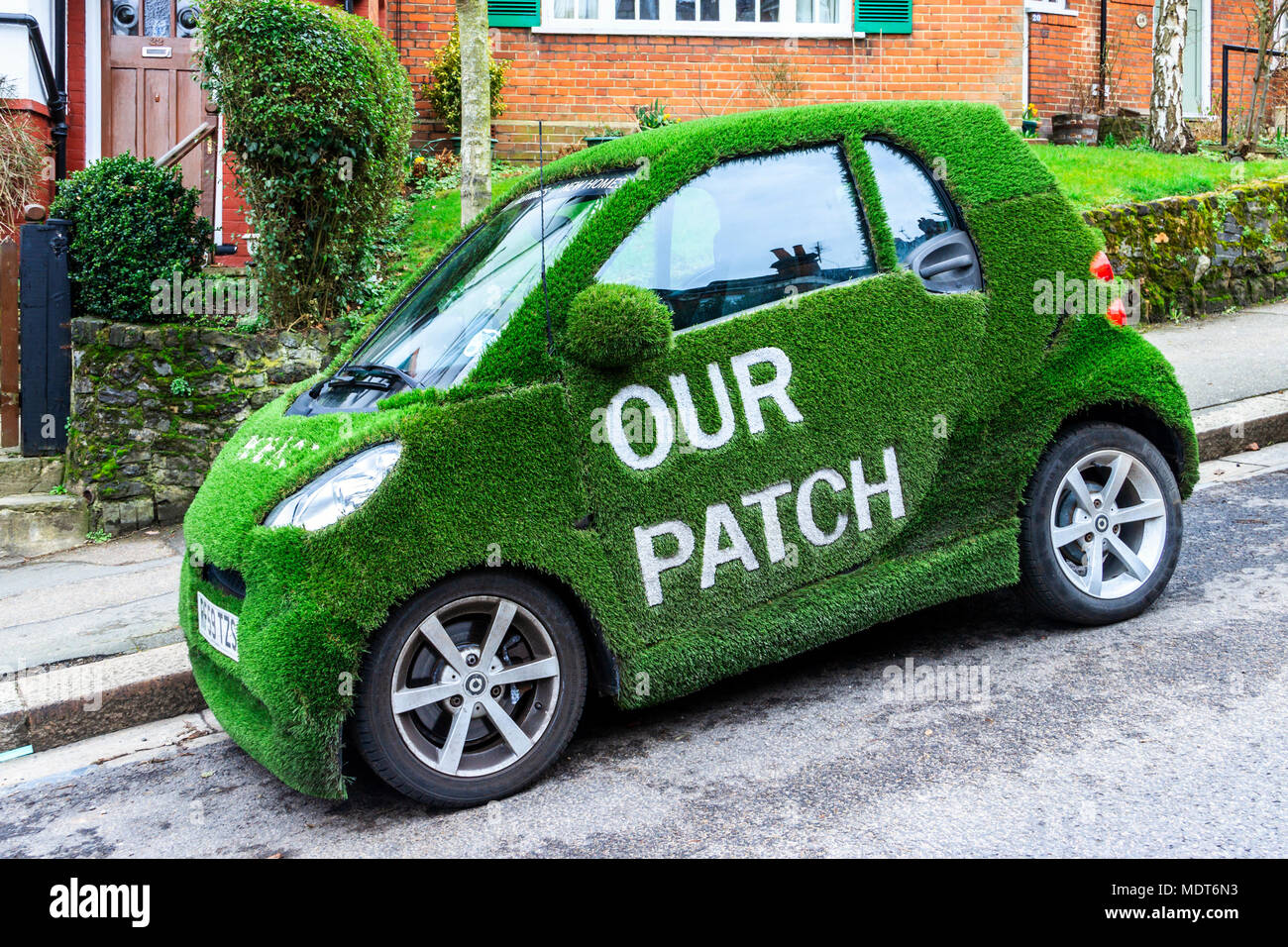 Greene & Co estate agents Smart car wrapped in green artificial grass, with the slogan 'Our Patch', Muswell Hill, London, UK Stock Photo