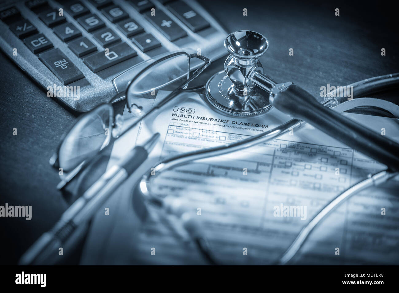 Filling out health insurance form - Stock Image