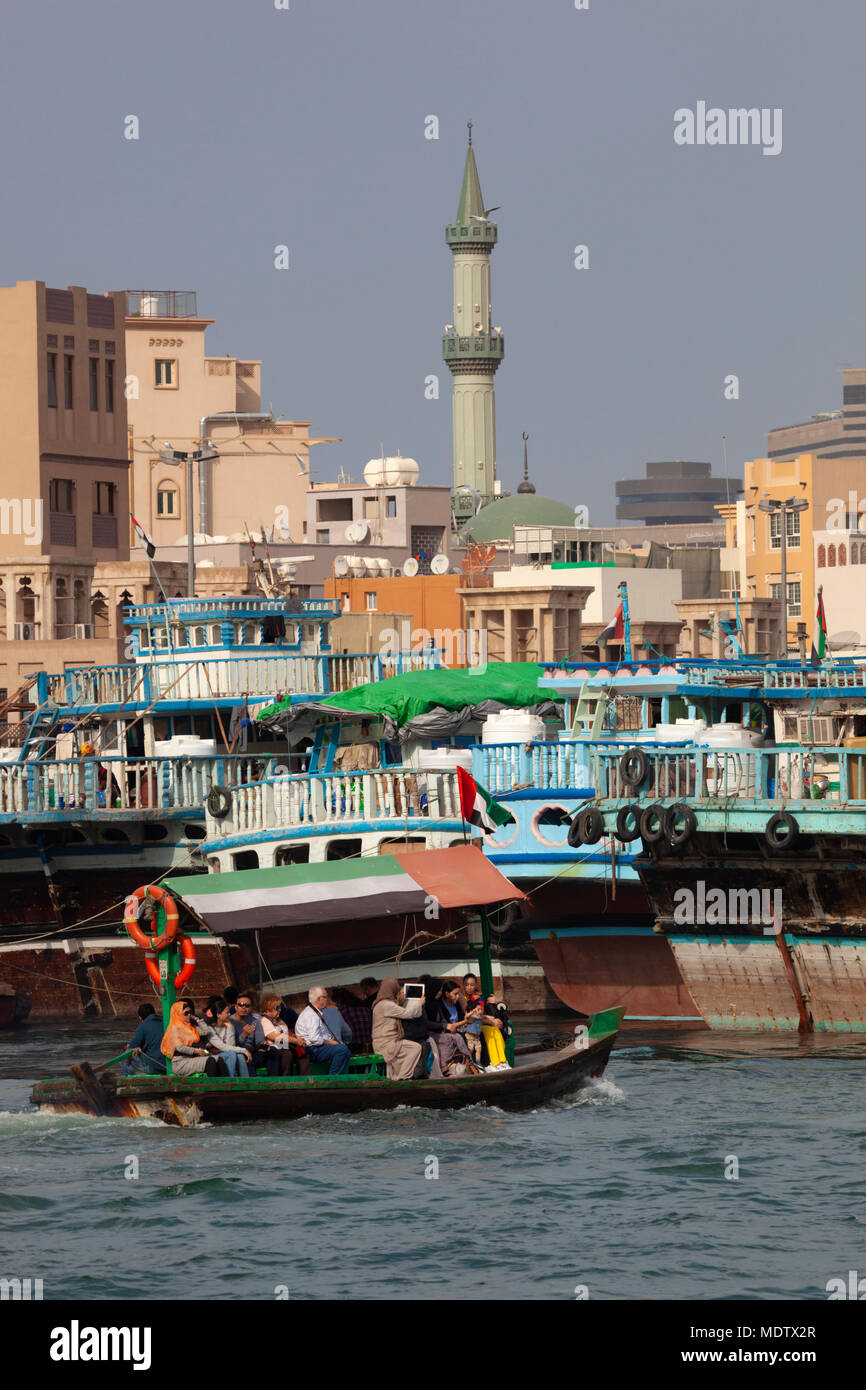 Local people crossing the Dubai Creek on an abra, Deira, Dubai, United Arab Emirates, Middle East - Stock Image