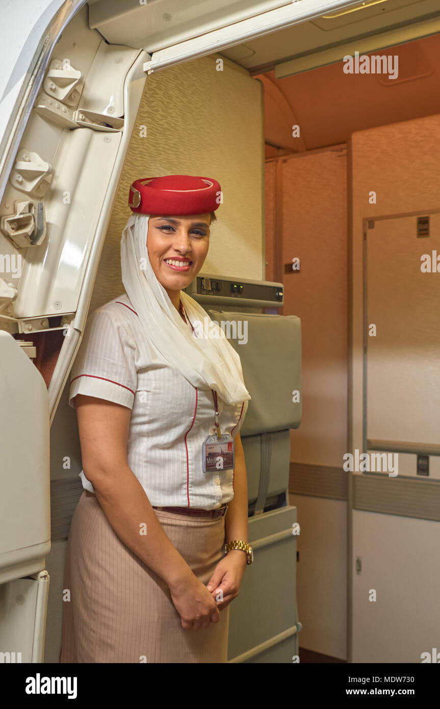 HONG KONG - NOVEMBER 16, 2015: Emirates cabin crew attendants on board of Boeing 777. - Stock Image