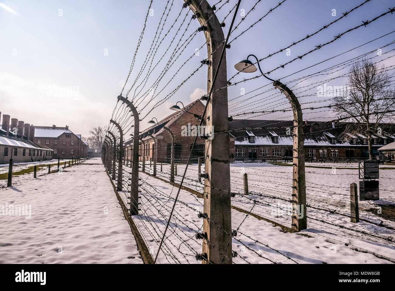 Auschwitz / Oswiecim / Poland - 02.15.2018: Barbed wire fence around a concentration camp. - Stock Image