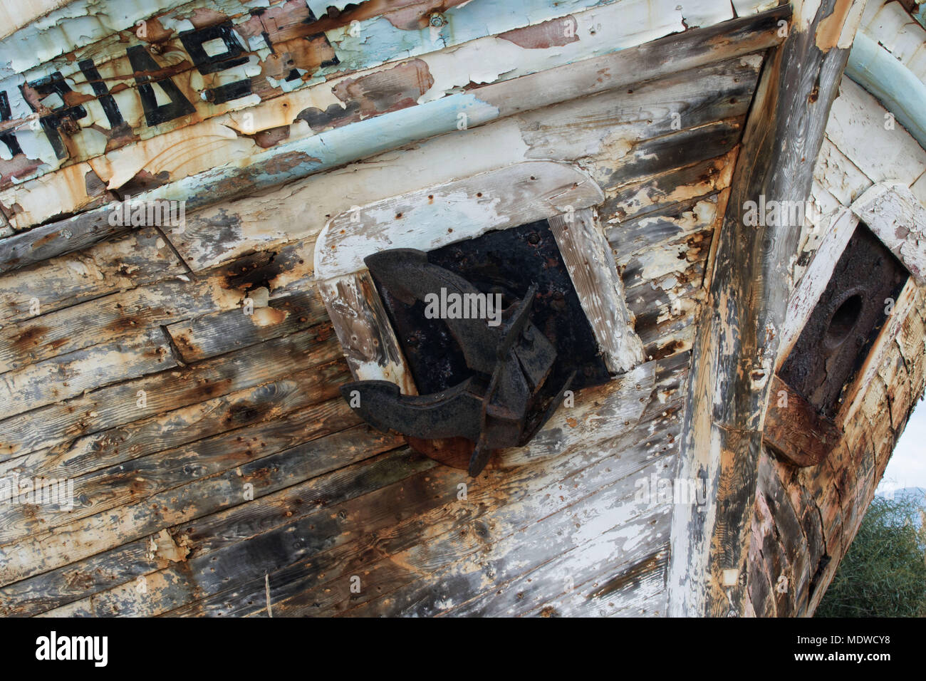 Close up of wooden boat in dry dock showing colourful peeling paint, Polis, Cyprus - Stock Image