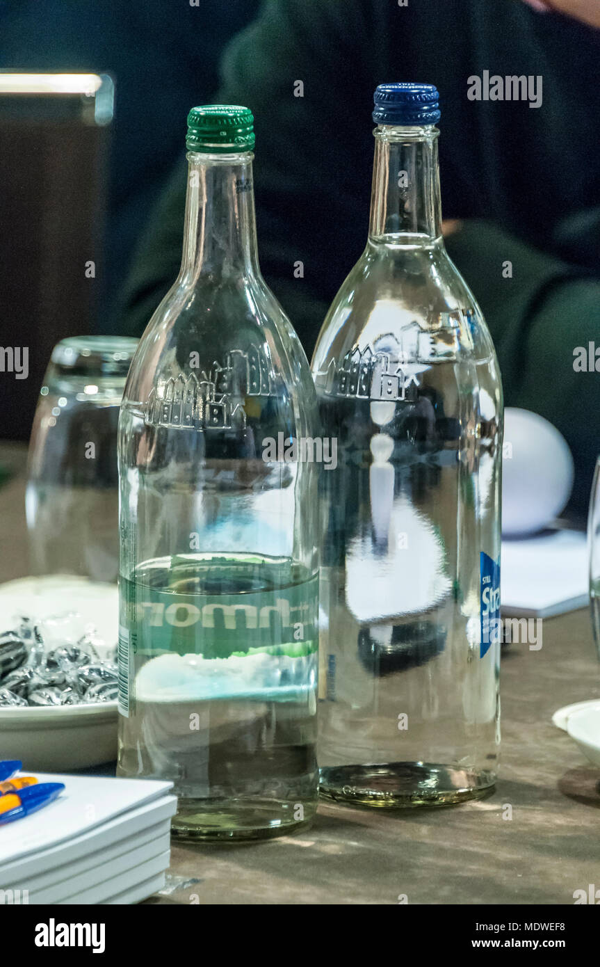 Mineral water bottles on a table. - Stock Image
