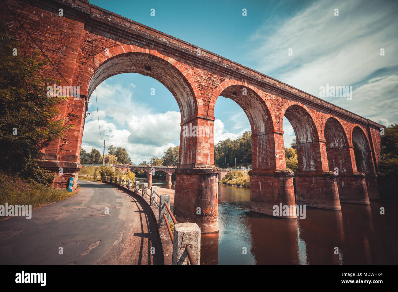 Huge arch train bridge built over Sorgue river in France - Stock Image