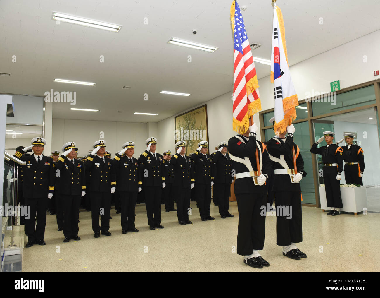 171207-N-TB148-042 CHINHAE, Republic of Korea (Dec. 07, 2017) Rear Adm. Brad Cooper, commander, U.S. Naval Forces Korea (CNFK), attends the unveiling of the Capt. Michael Lousey memorial bust unveiling ceremony at Republic of Korea (ROK) Naval Academy in Chinhae. CNFK is the U.S. Navy's representative in the ROK, providing leadership and expertise in naval matters to improve institutional and operational effectiveness between the two navies and to strengthen collective security efforts in Korea and the region. (U.S. Navy photo by Mass Communication Specialist Seaman William Carlisle) Stock Photo