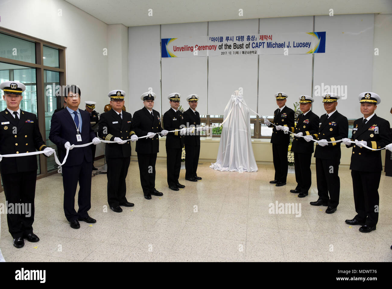 171207-N-TB148-048 CHINHAE, Republic of Korea (Dec. 07, 2017) Rear Adm. Brad Cooper, commander, U.S. Naval Forces Korea (CNFK), attends the unveiling of the Capt. Michael Lousey memorial bust unveiling ceremony at Republic of Korea (ROK) Naval Academy in Chinhae. CNFK is the U.S. Navy's representative in the ROK, providing leadership and expertise in naval matters to improve institutional and operational effectiveness between the two navies and to strengthen collective security efforts in Korea and the region. (U.S. Navy photo by Mass Communication Specialist Seaman William Carlisle) Stock Photo