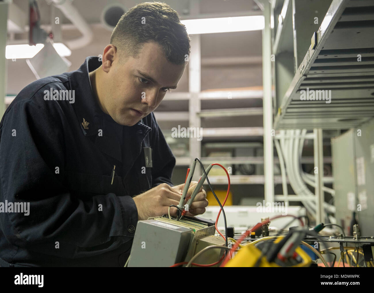 ATLANTIC OCEAN (Dec. 9, 2017) Aviation Electronic's Technician 2nd Class Justin Milligan troubleshoots a radar altimeter in the instrument shop aboard the Nimitz-class aircraft carrier USS Abraham Lincoln (CVN 72). (U.S. Navy photo by Mass Communication Specialist 3rd Class Darion Chanelle Triplett/Released) Stock Photo