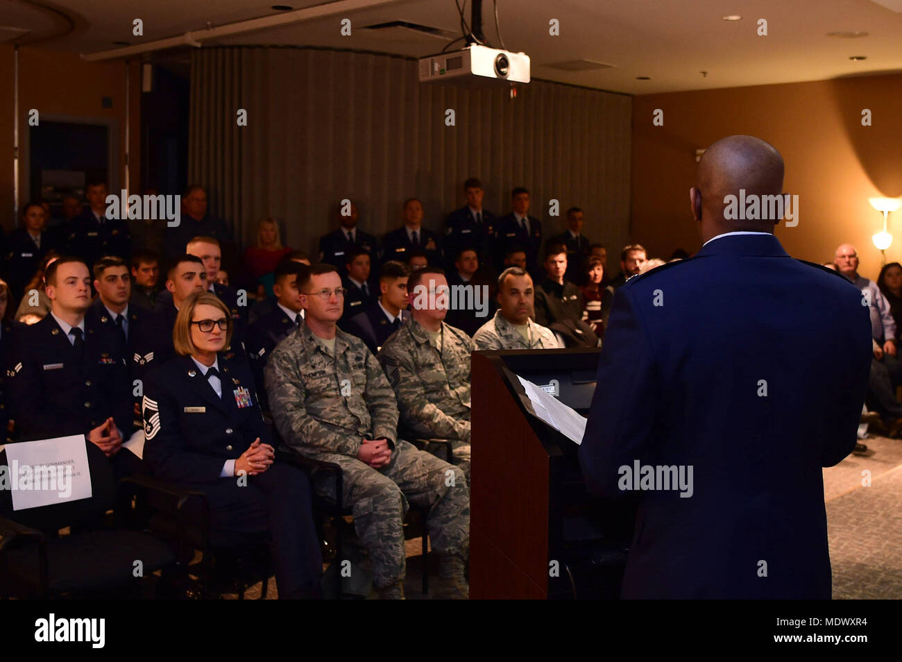 Lt. Col. Erik Welcome, 460th Space Communications Squadron commander, speaks to an audience on the dangers of drinking and driving Dec. 7, 2017, on Buckley Air Force Base, Colorado. Each year, the 460th SCS gathers to honor Senior Airman Michael S. Snyder and Staff Sgt. Kristopher G. Mansfield who both had their lives taken in drunk driving accidents. (U.S. Air Force photo by Senior Airman Luke W. Nowakowski) - Stock Image